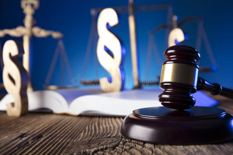 Law theme and concept. Lawyer, counselor office. Consultation with a lawyer concept. Gavel and scale of justice on old wooden table and blue background royalty free stock image