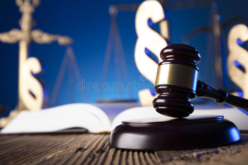 Law theme and concept. Lawyer, counselor office. Consultation with a lawyer concept. Gavel and scale of justice on old wooden table and blue background royalty free stock photography