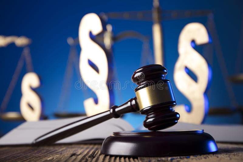 Law theme and concept. Lawyer, counselor office. Consultation with a lawyer concept. Gavel and scale of justice on old wooden table and blue background royalty free stock images