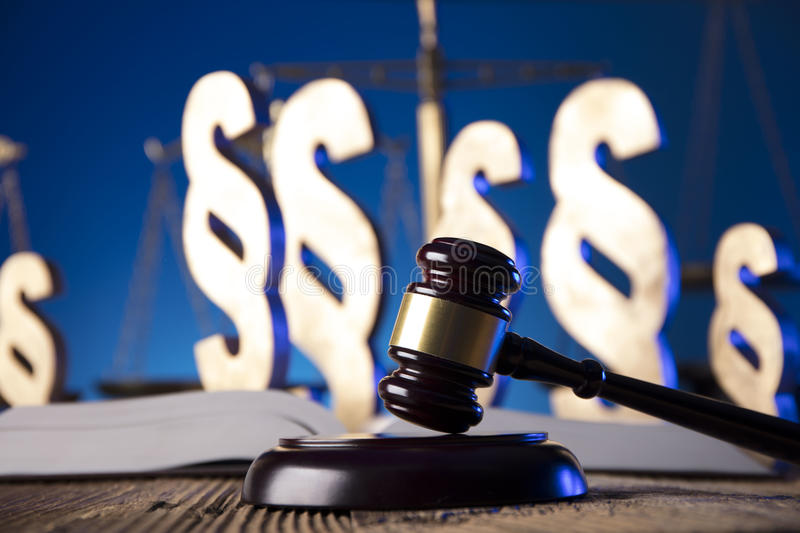 Law theme and concept. Lawyer, counselor office. Consultation with a lawyer concept. Gavel and scale of justice on old wooden table and blue background royalty free stock photo