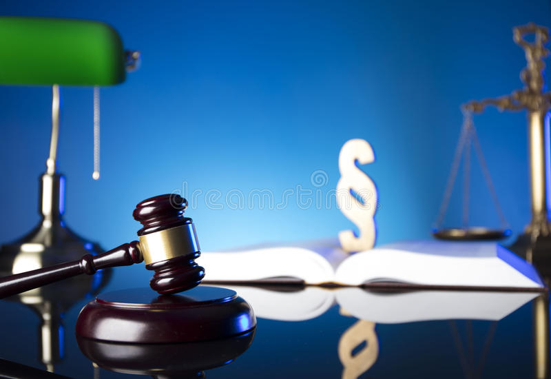 Law theme and concept. Lawyer, counselor office. Consultation with a lawyer concept. Gavel and scale of justice on old wooden table and blue background royalty free stock photos