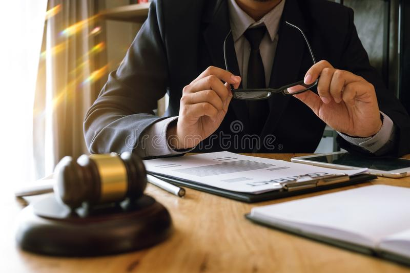 Law theme  wooden desk, books, balance. Law concept. Justice and law concept.Male judge in a courtroom on wooden table and Counselor or Male lawyer working in royalty free stock photography