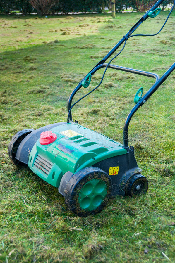 Lawn aerator. Removing moss from garden royalty free stock photography