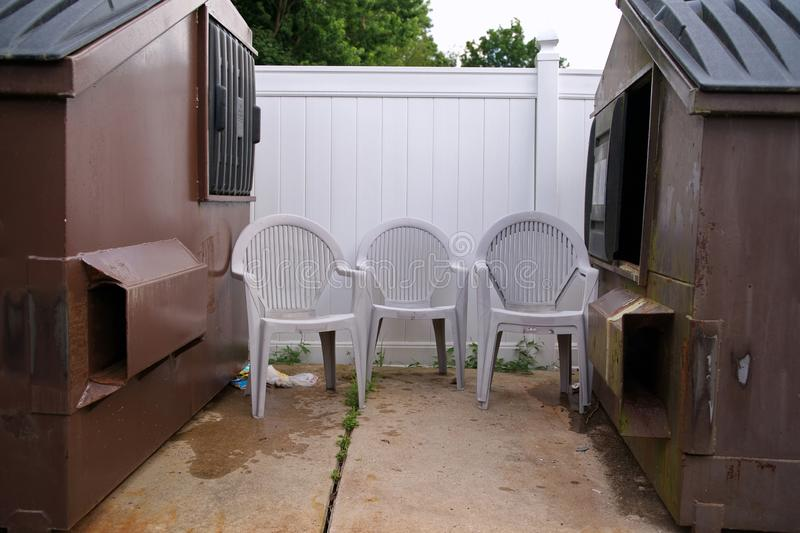 Lawn Chairs by Dumpsters stock photos
