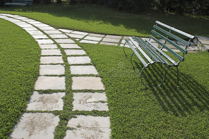 Lawn chairs on green grass stock image