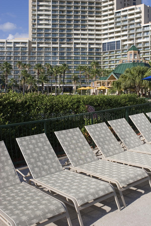 Lawn chairs at a hotel royalty free stock photo