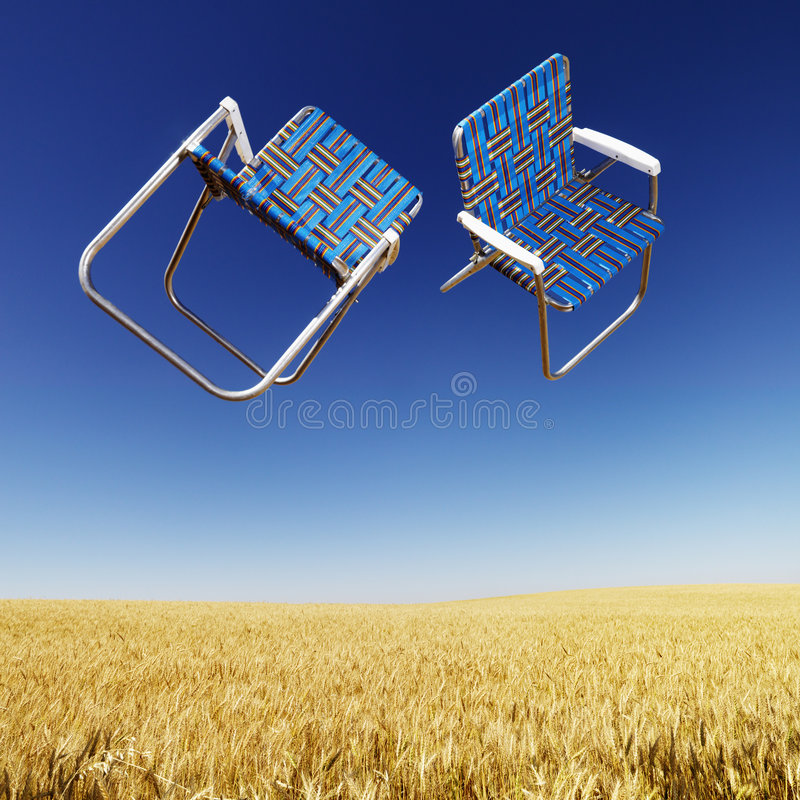 Free Lawn Chairs Over Wheat Field. Stock Images - 3188344