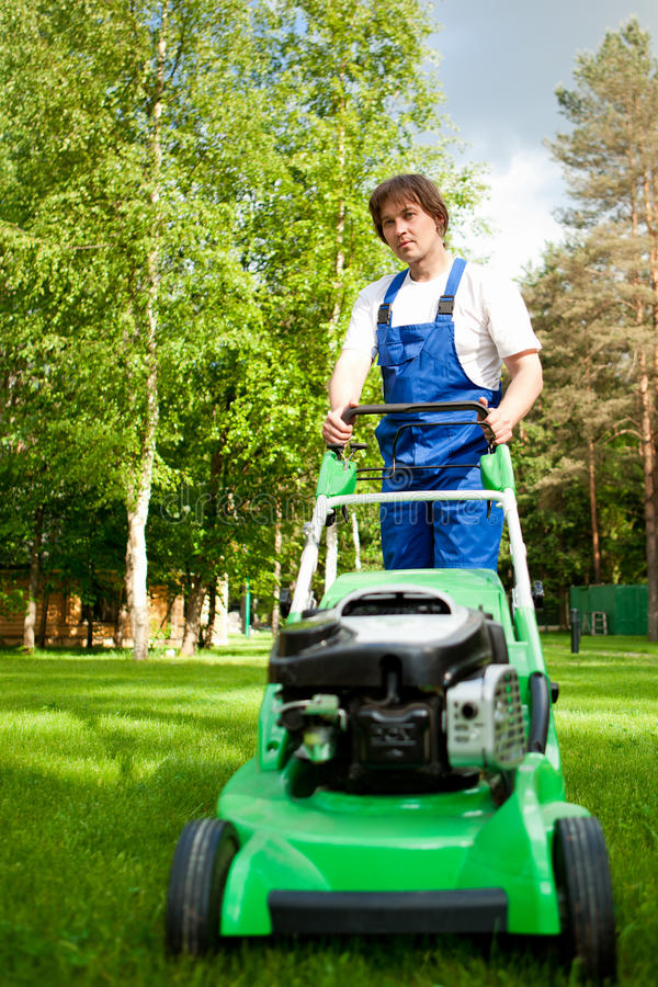 Lawn mover man stock photography