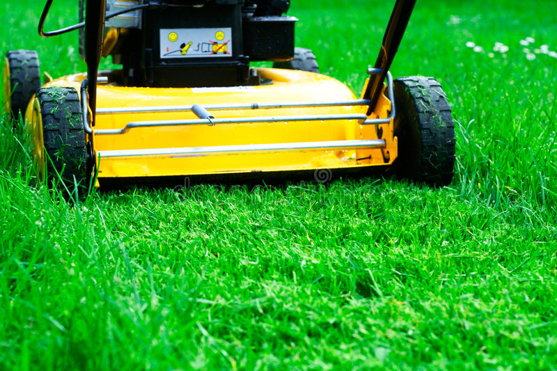 Lawn mower. And its new-clipped trail stock image