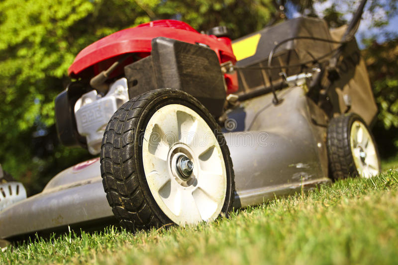 Lawn Mower. Detail of classic Lawn Mower on green grass background royalty free stock image