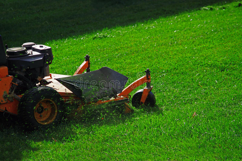 Commercial Lawn Mower. On Green Lawn stock photography