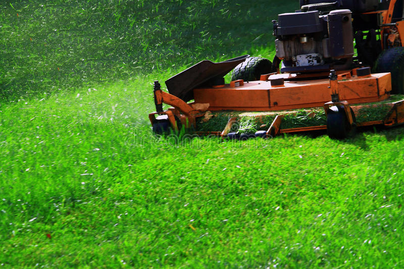 Lawn Mower. Commercial Lawn Mower on Green Lawn