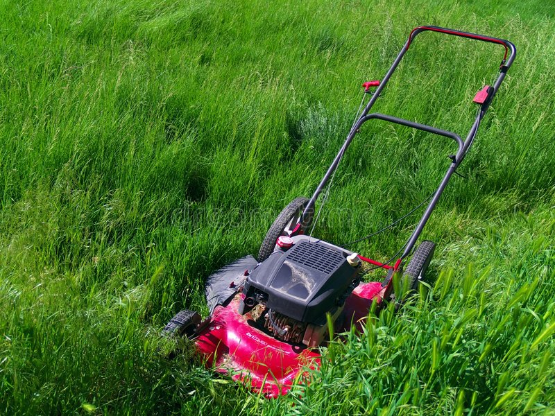 Lawn mower in extremely long grass stock images