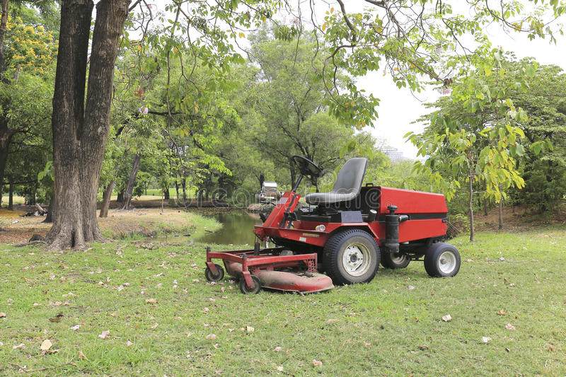 Lawn mower on field stock photography