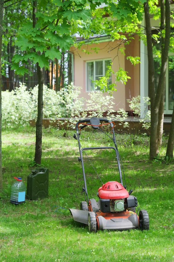 Lawn mower. In the garden royalty free stock photo