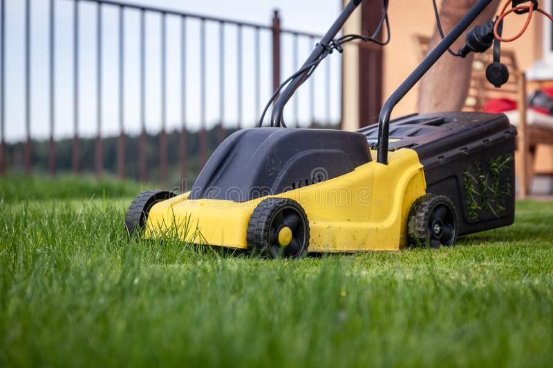 Lawn mower mower, grass, equipment, mowing, gardener, care, work, tool. Lawn mower, green grass, equipment, mowing, gardener, care, work, tool, home, housekeeper stock images