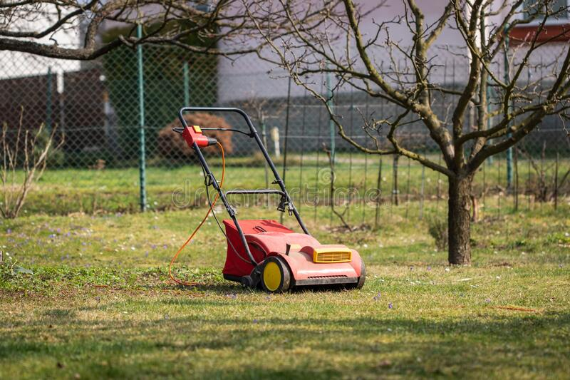 Lawn mower for verticutting in garden royalty free stock photo