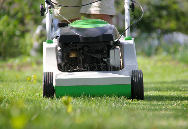 Download Lawn mower at work stock image. Image of mowing, people - 19686687