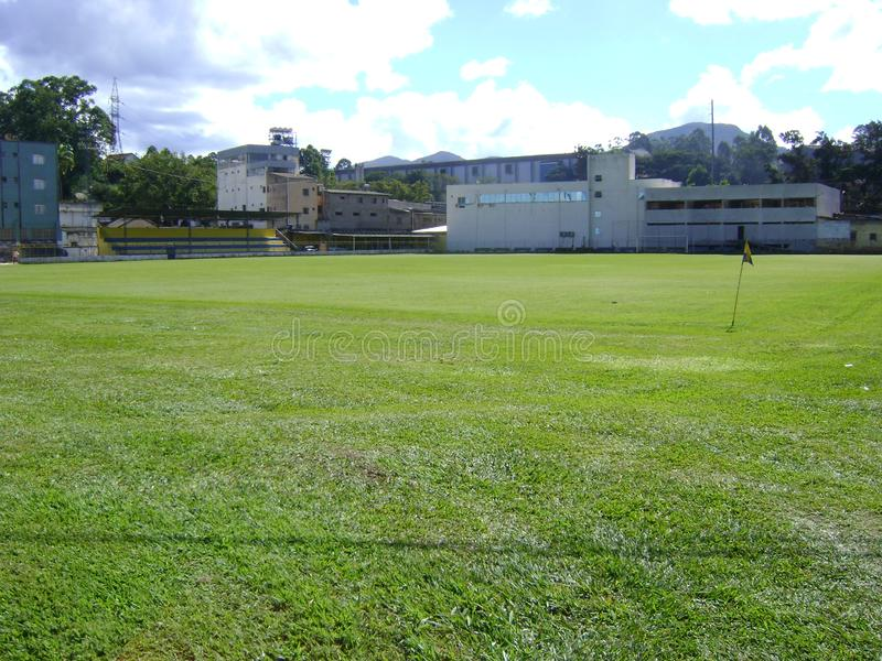 Lawn of the soccer stadium in Barrão de Cocais. Football stadium, with lateral buildings, in the center of Barrão de Cocais, inner city of Minas Gerais royalty free stock photography