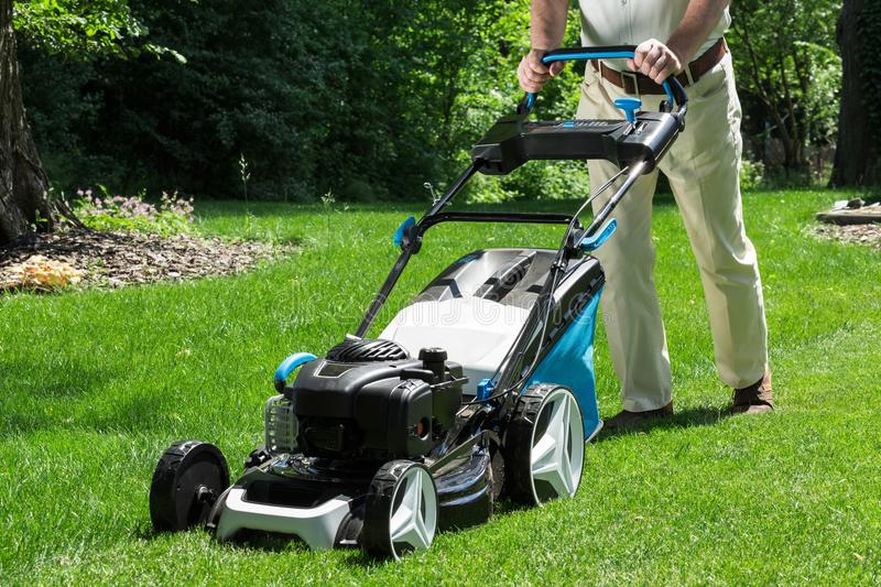 Lawnmower in action royalty free stock image