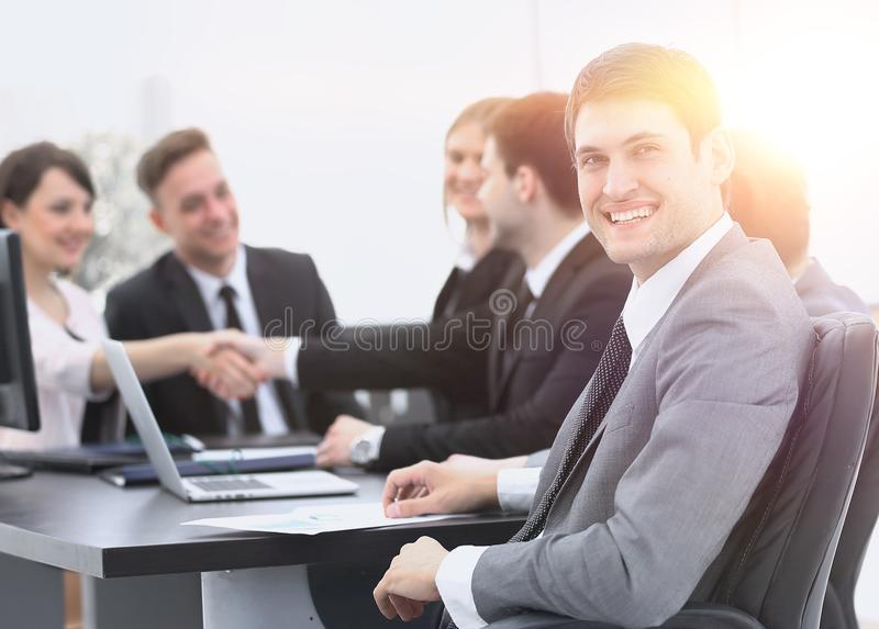 Lawyer on the background of business partners handshaking stock photography