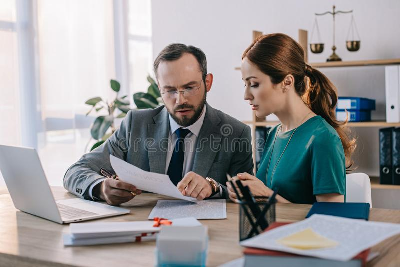 lawyer and client discussing contract at workplace with laptop royalty free stock photos