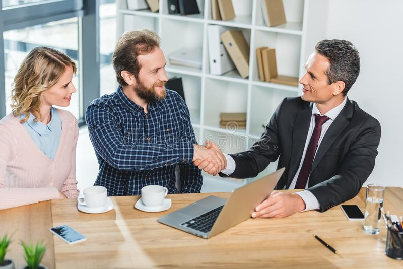 Lawyer and client shaking hands royalty free stock photo
