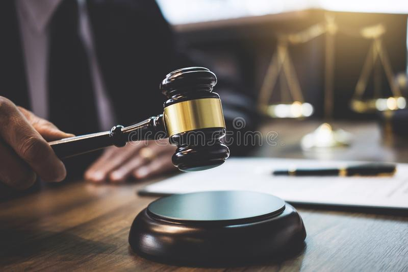 Lawyer or counselor working on a documents and holding gavel in. Courtroom, Justice and Law concept royalty free stock images