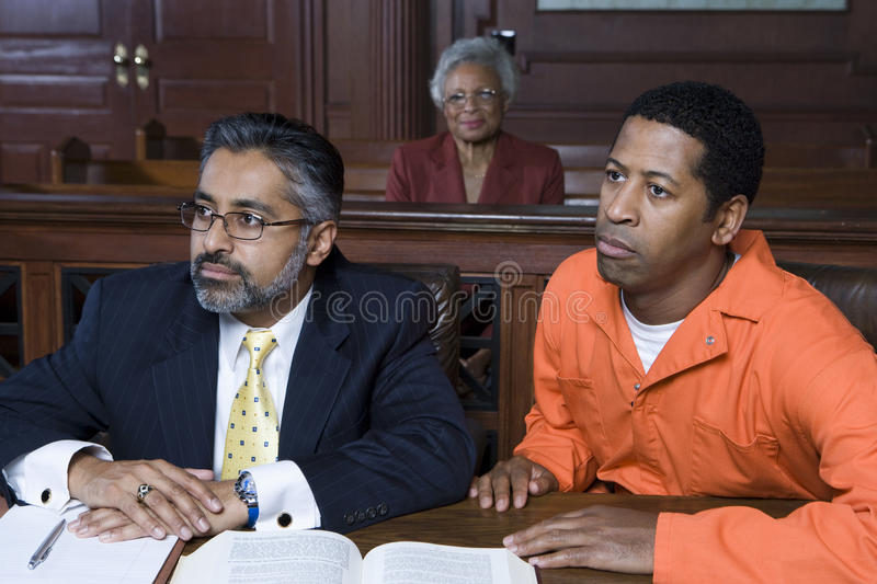 Lawyer And Criminal In Court stock photos