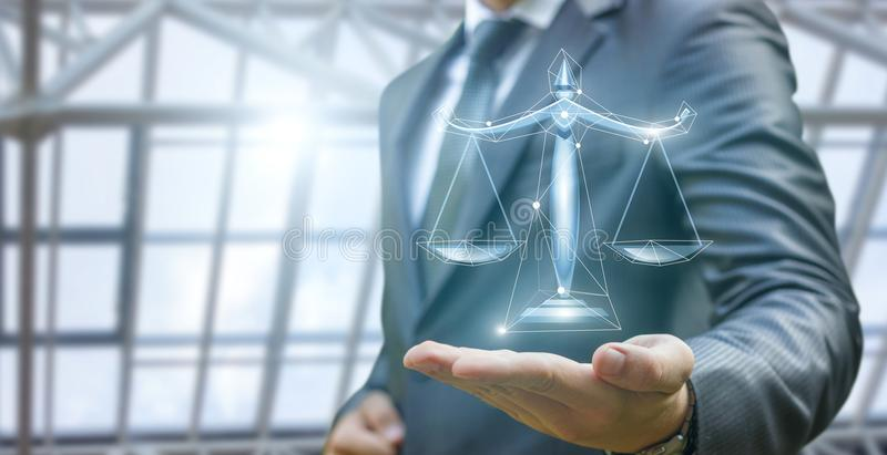 Lawyer demonstrates the scales of justice . stock image