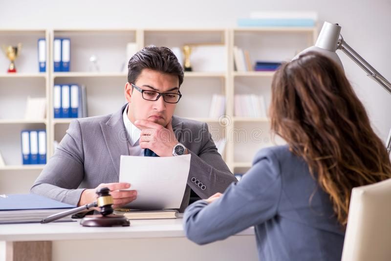The lawyer discussing legal case with client. Lawyer discussing legal case with client stock image