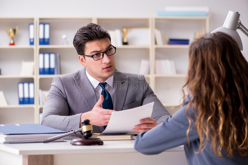 The lawyer discussing legal case with client. Lawyer discussing legal case with client royalty free stock photography