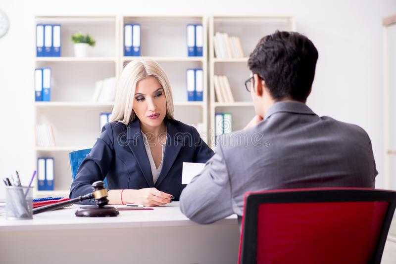 The lawyer discussing legal case with client. Lawyer discussing legal case with client stock photo