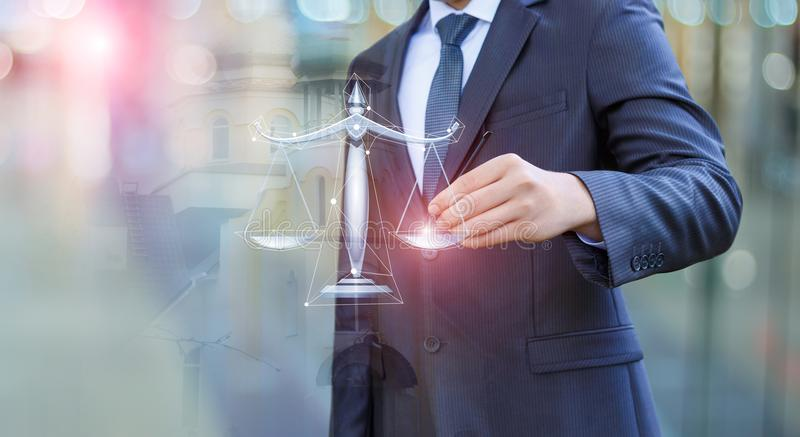 Lawyer draws the scales of justice. stock images