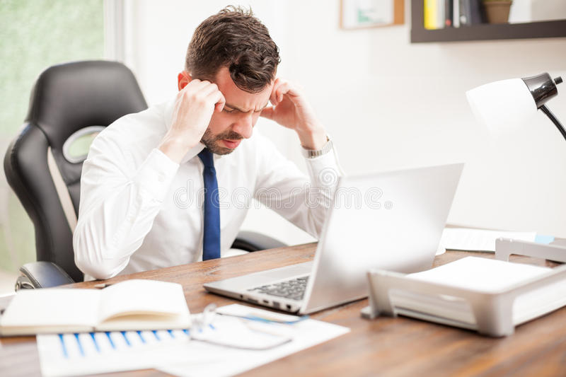 Lawyer feeling stressed at work royalty free stock photography
