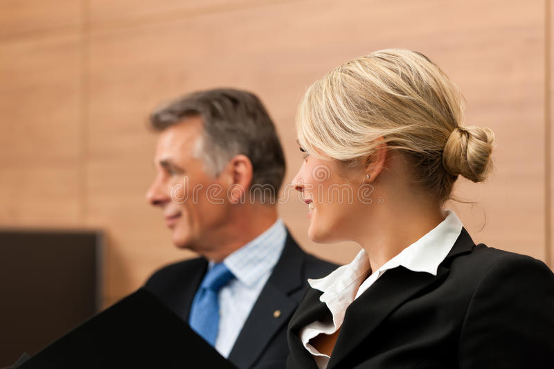 Lawyer with his secretary. Awyer with his secretary in his office, he obviously is dictating something stock images