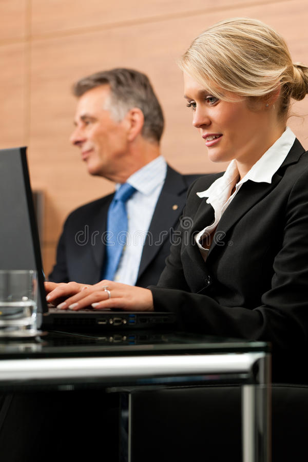 Lawyer with his secretary. Awyer with his secretary in his office, he obviously is dictating something royalty free stock image