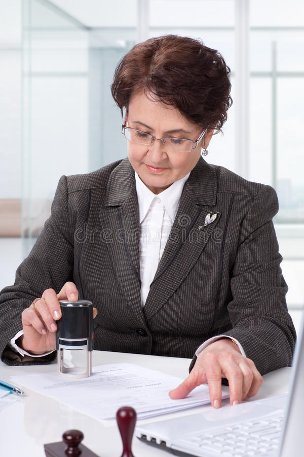 Lawyer on his workplace Signing contract stock image