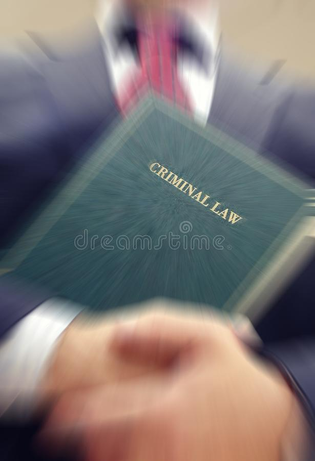 Lawyer holding a Criminal Law book. stock photo