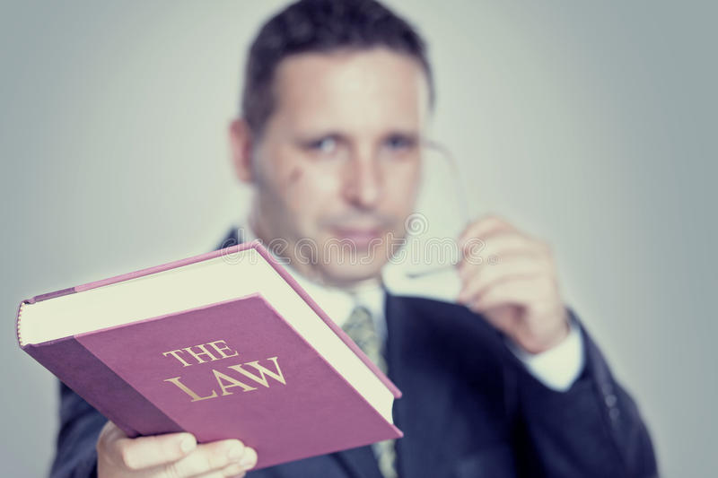 The Lawyer. Lawyer holding a red book, law and justice concept stock photo