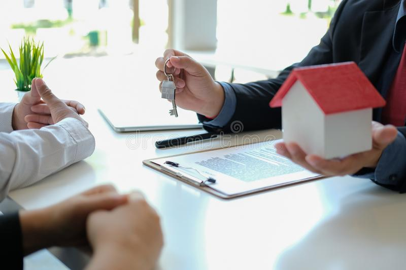 Lawyer insurance broker consulting giving legal advice to couple customer about buying renting house. financial advisor with. Mortgage loan investment contract royalty free stock image