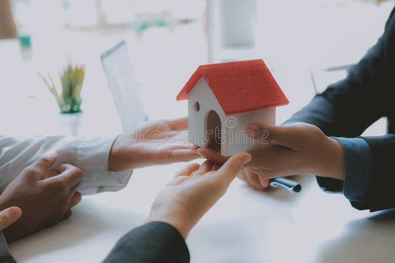 Lawyer insurance broker consulting giving legal advice to couple customer about buying renting house. financial advisor with. Mortgage loan investment contract royalty free stock images
