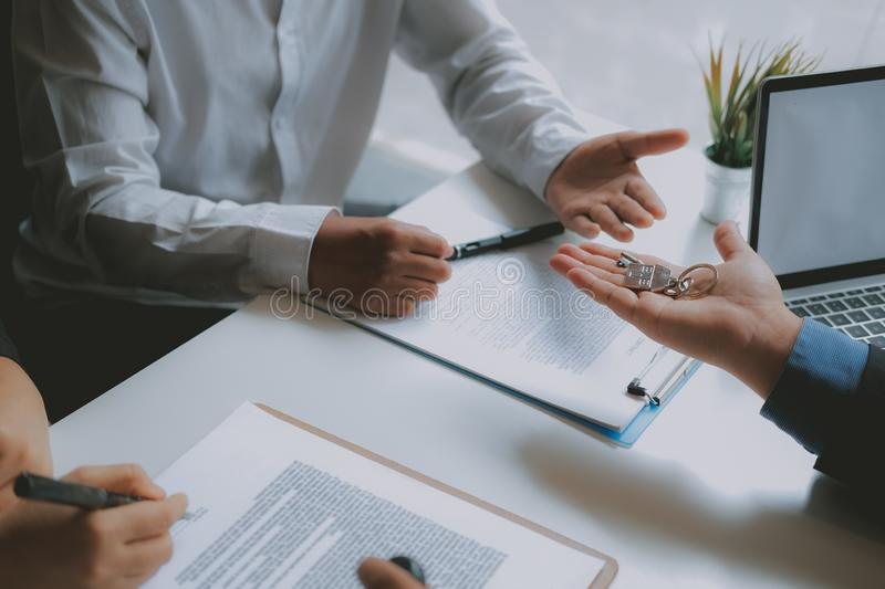 Lawyer insurance broker consulting giving legal advice to couple customer about buying renting house. financial advisor with. Mortgage loan investment contract stock image