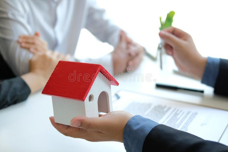 Lawyer insurance broker consulting giving legal advice to couple customer about buying renting house. financial advisor with. Mortgage loan investment contract royalty free stock photography