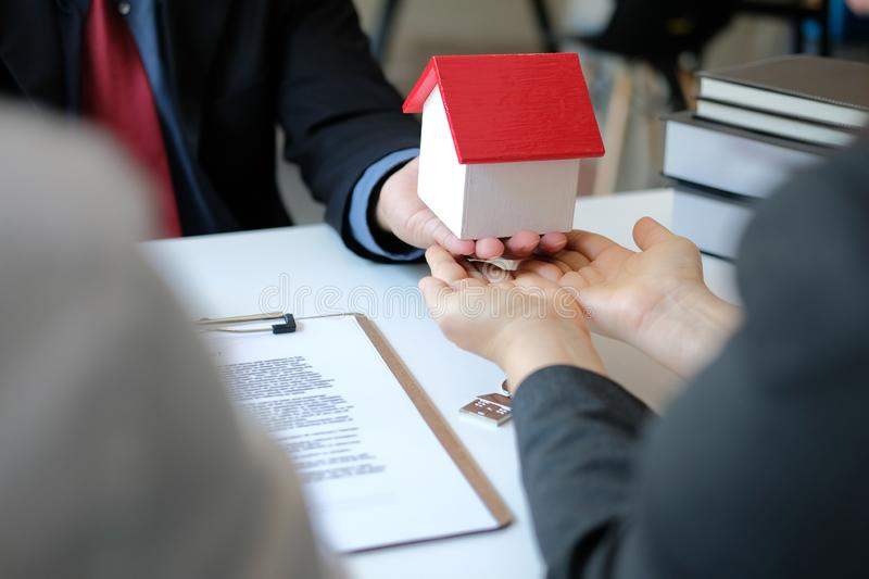 Lawyer insurance broker consulting giving legal advice to couple customer about buying renting house. financial advisor with. Mortgage loan investment contract stock photos