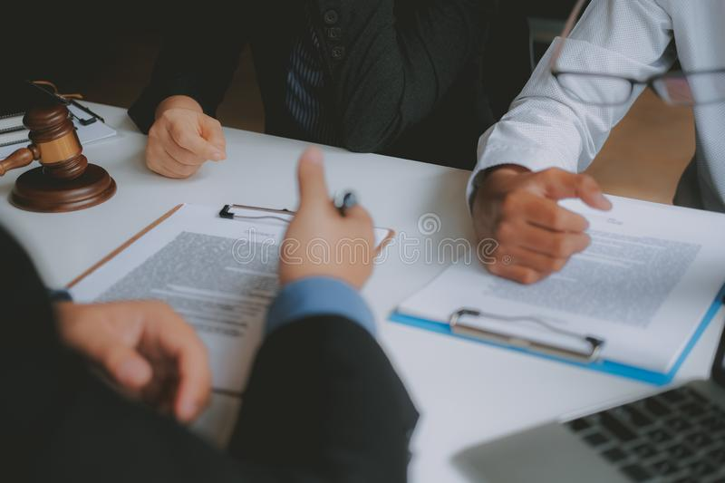 Lawyer insurance broker consulting giving legal advice to couple customer about buying renting house. financial advisor with. Mortgage loan investment contract stock photography