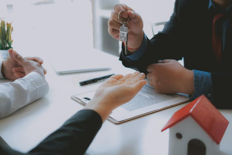 Lawyer insurance broker consulting giving legal advice to couple customer about buying renting house. financial advisor with mortg. Age loan investment contract stock photo