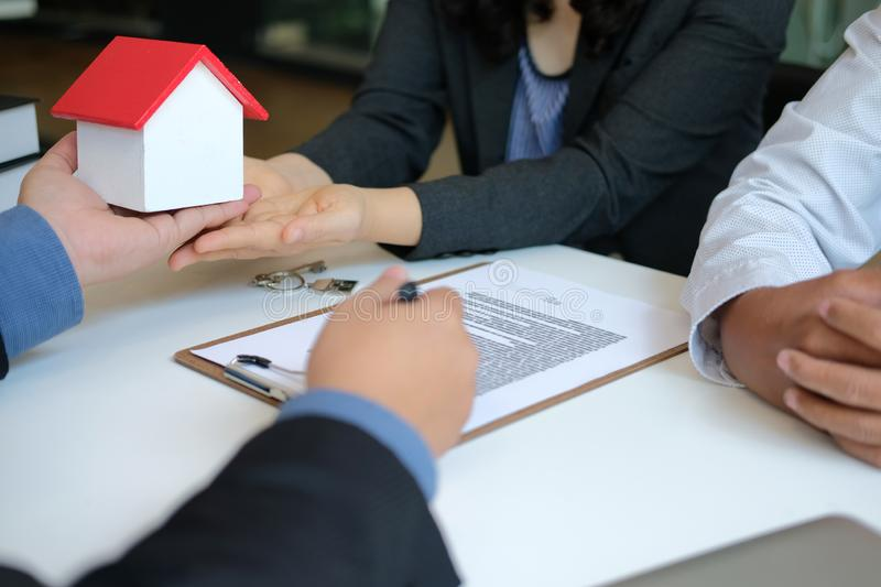 Lawyer insurance broker consulting giving legal advice to couple customer about buying renting house. financial advisor with. Mortgage loan investment contract stock photo