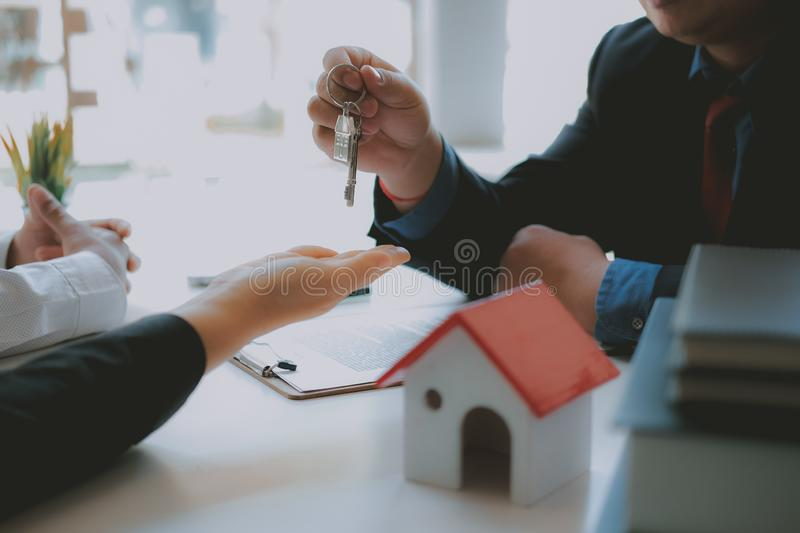 Lawyer insurance broker consulting giving legal advice to couple customer about buying renting house. financial advisor with. Mortgage loan investment contract royalty free stock photos