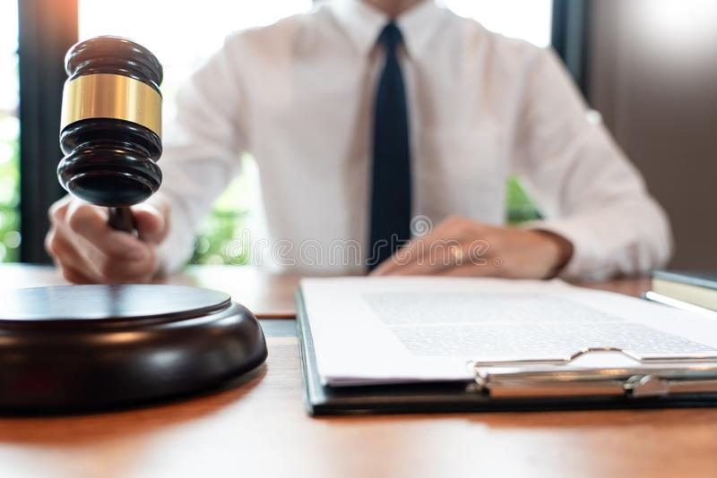 Lawyer or judge business man working with paperwork agreement contract and gavel in Courtroom, Justice and Law firm Notary public. Concept royalty free stock photo